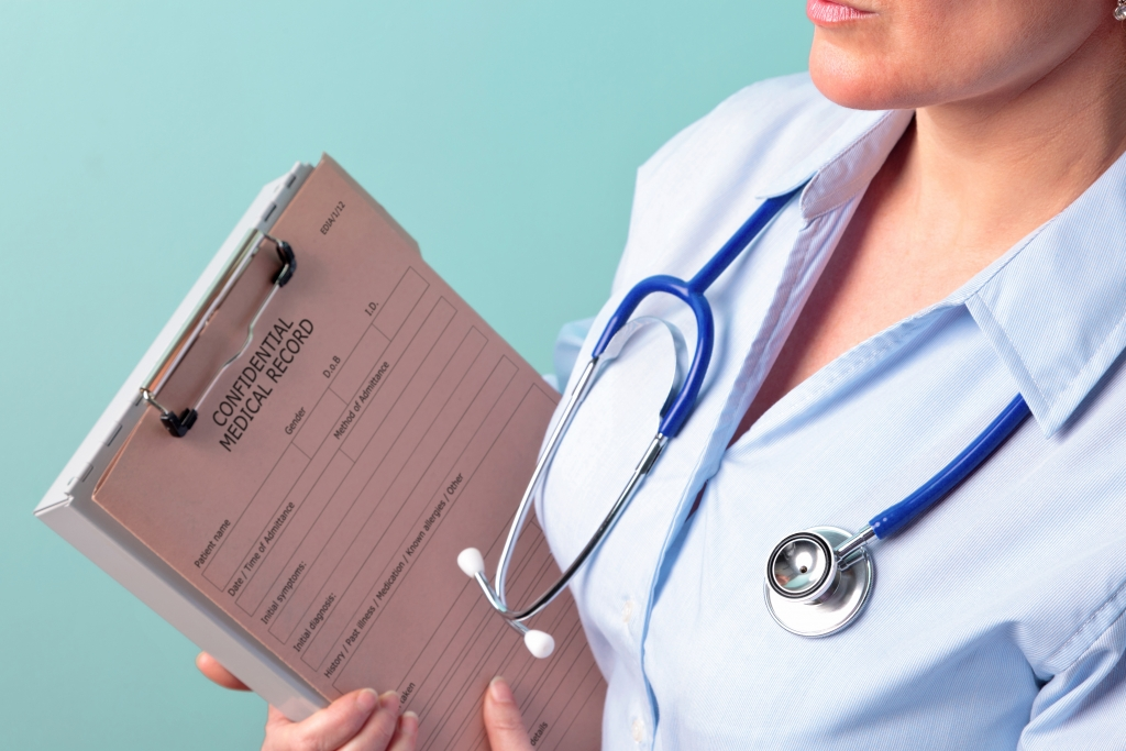 Nurse holding confidential medical records - Health Care Information