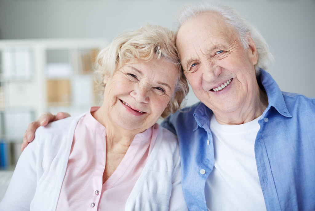Elderly couple smiling - end of life