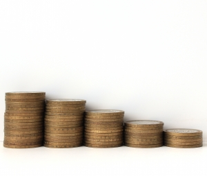 Compensation - money stack going down